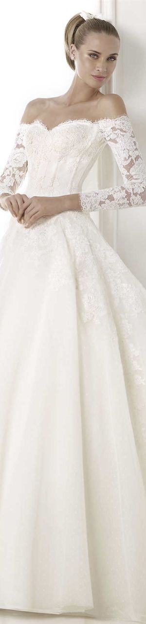 Long sleeved off shoulder winter wedding gown. I just love this neckline. PRONOVIAS 2015 Glamour Bridal Collection