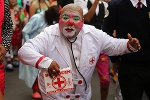 A clown appears ready to administer first aid