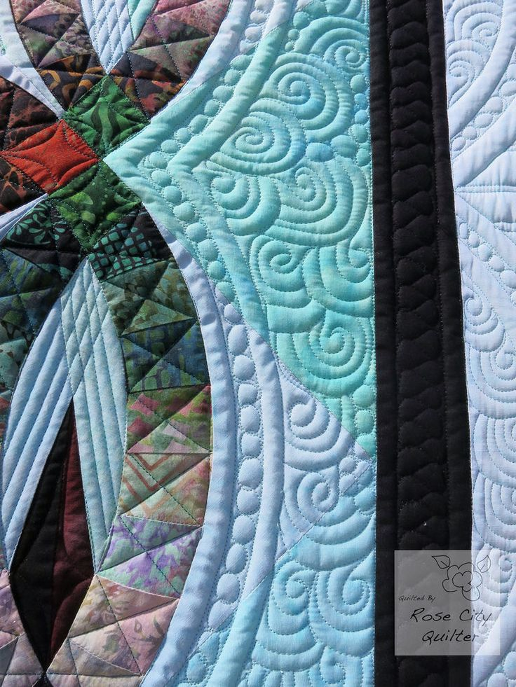 Pieced by Phyllis Holte Quilted by her daughter Ardelle Kerr (RoseCity Quilter) Pattern, Bali Wedding Star by Juday and Brad Niemeyer of Quiltworx