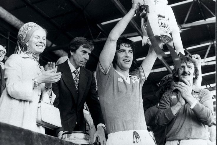Manchester United Captain, Martin Buchan, holds aloft the FA Cup at Wmebley after receiving the Trophy from the Duchess of Kent. United beat Liverpool 2-1.