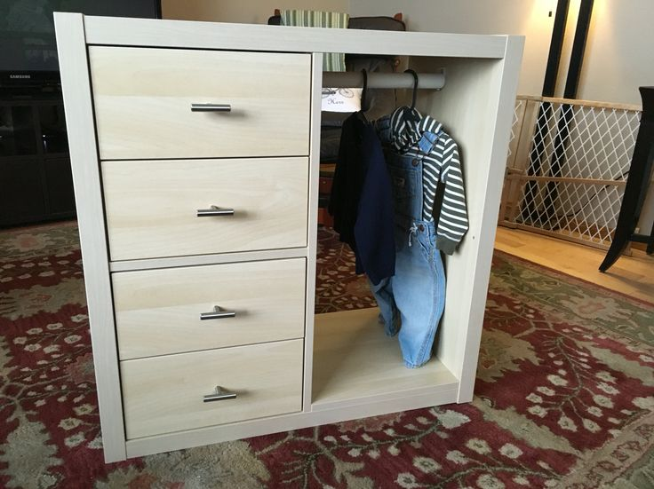 Ikea hack of Kallax shelf to make a Montessori Wardrobe with 4 drawers and custom hardware for a toddler's nursery.