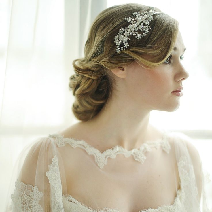 Etienne Pearl Bridal Headband - This gorgeous pearl wedding hairband is made up of pearls in a variety of sizes interspersed with diamante details. The hairband has a vintage feel and shows up beautifully in the hair, without being too overstated.