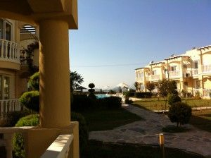 Mandalya Bay Apartment, Tuzla - Located on a fantastic development overlooking Mandalya Bay is this lovely two bedroom resale apartment.  The apartment is set back from one of many communal swimming pool, has sea views from the patio area. Price: £52,500