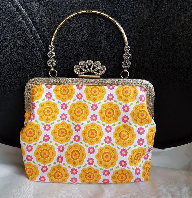 Lovely vintage style kiss lock handbag, entirely handstitched