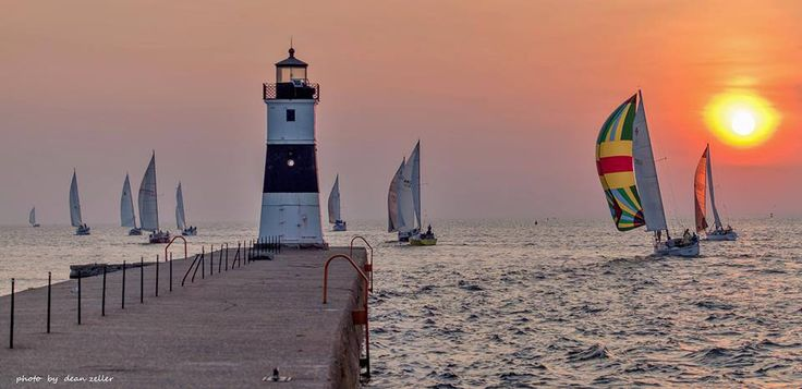 sailboats leaving Presque Isle Bay at sunrise last weekend to head to Port Dover, Ontario, for the annual Lake Erie Interclub races.