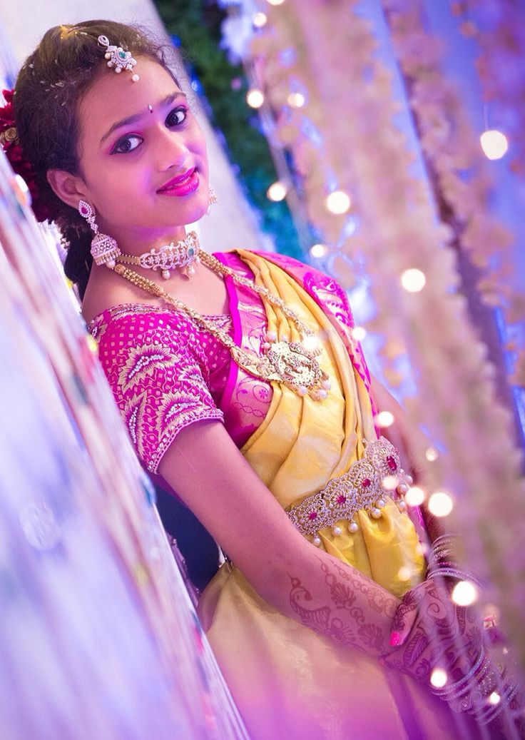 South Indian bride. Temple jewelry. Jhumkis.yellow silk kanchipuram sari with contrast blouse.Braid with fresh jasmine flowers. Tamil bride. Telugu bride. Kannada bride. Hindu bride. Malayalee bride.Kerala bride.South Indian wedding.