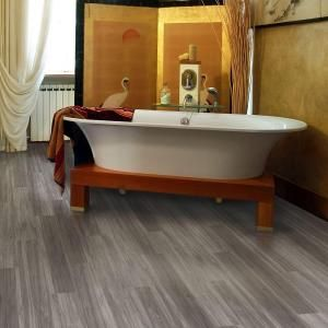 TrafficMaster Allure Plus Grey Maple 5 in. x 36 in. Resilient Vinyl Plank Flooring (22.5 sq. ft. / case) | Home Depot Installs in floating planks like wood and laminate, but it's waterproof! Can be installed in kitchens and bathrooms.