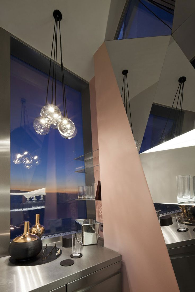 Apartment: Stylish Ritz Apartment in Almaty, Kazakhstan by COORDINATION, Contemporary Ritz Apartment Kitchen Decorating Idea by COORDINATION with Futuristic Shape and Stainless Steel Cabinets and Glass Pendant Lamps