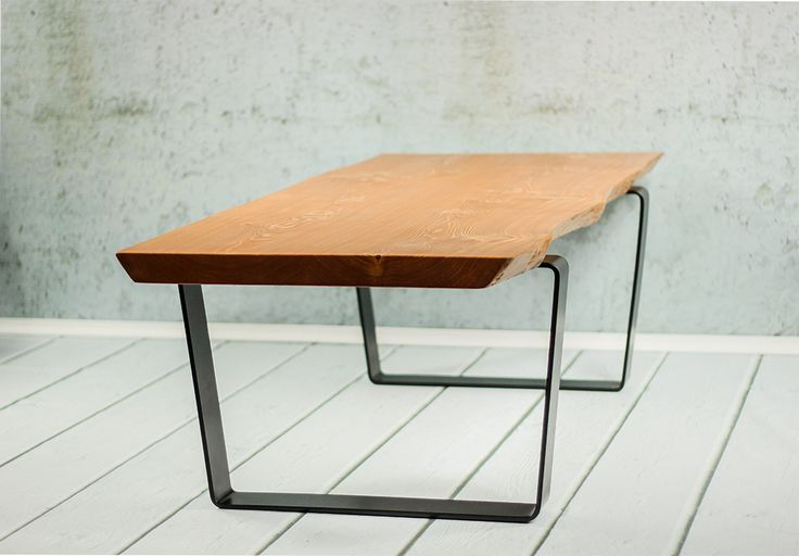 Annivier Boat Coffee Table - A massive coffee table with live edge design in larch wood. It features equally attractive pair of steel legs in black color.