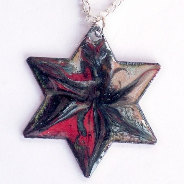 pendant - 6 pointed star scrolled black and red on clear enamel £7.50