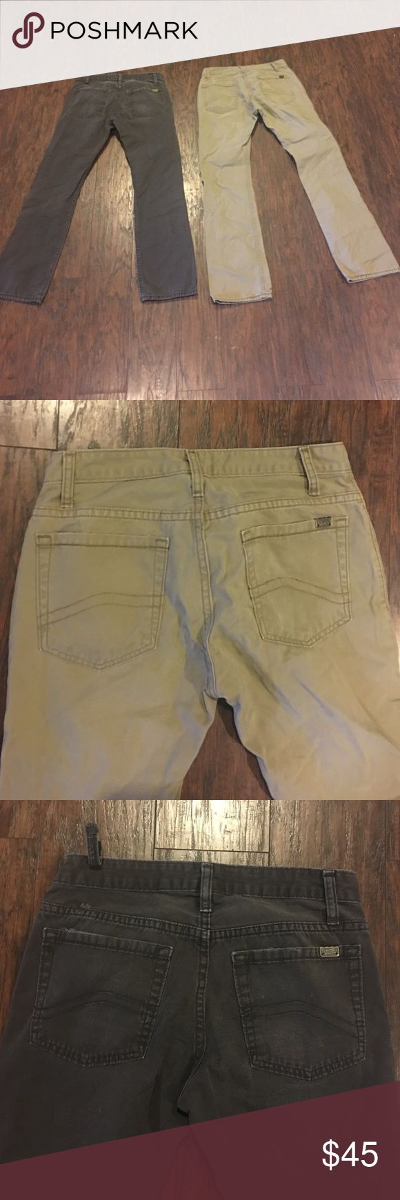 "Lot 2 pairs of Vans men's pants Sz 28 Lot 2 pairs of Vans men's pants Sz 28 good condition light wear grey pair has one belt loop detached from one side Inseam 28"" khaki pair inseam 29"" sold as lot only Vans Pants Chinos & Khakis"