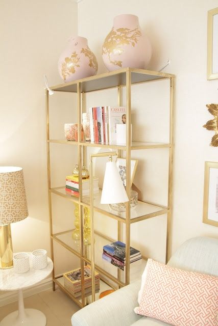 this bookshelf is the Ikea Vittsjo shelf spray painted gold and with added mirrors for bottom and top shelves {smart}