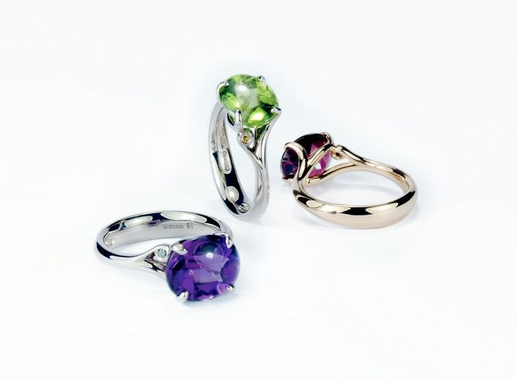 18ct Fairtrade gold Buff top Meadow rings with Rhodalite garnet, peridot and amethyst, each set with little diamonds as highlights. #Fairtrade #Fairtradefortnight #Fairtradegold #cocktailring #Dressring