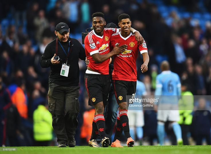 Winning goalscorer Marcus Rashford of Manchester United (R) and team mate Timothy Fosu-Mensah celebrate victory after the Barclays Premier League match between Manchester City and Manchester United at Etihad Stadium on March 20, 2016 in Manchester, United Kingdom.