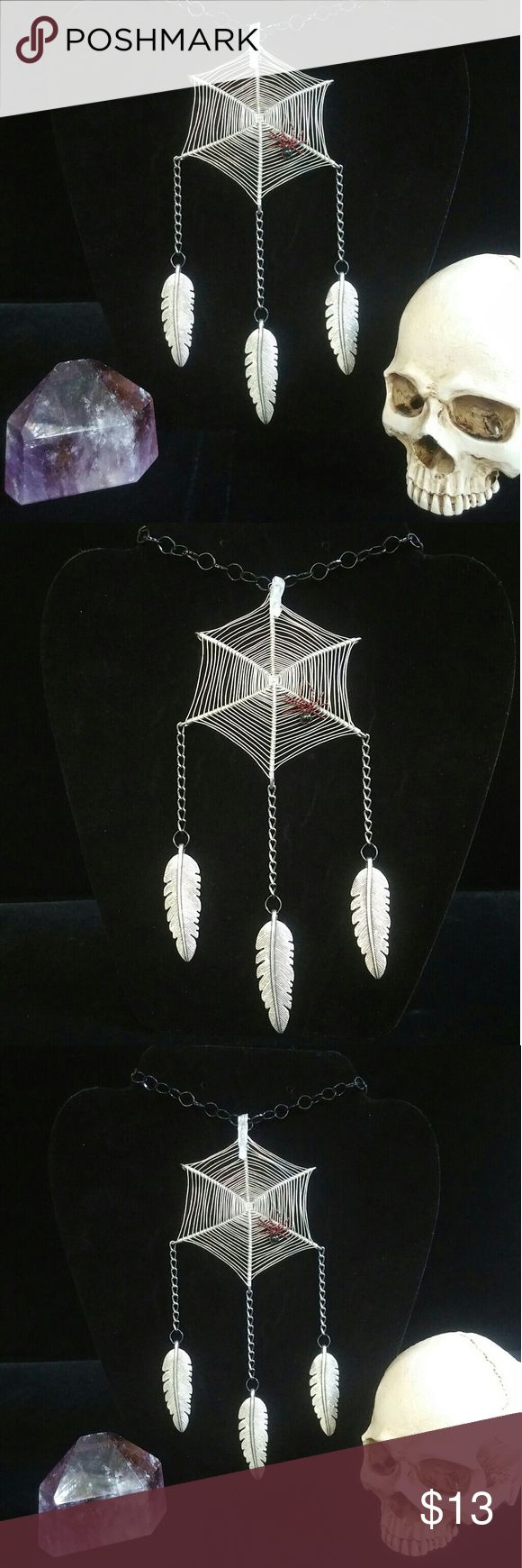 Crystal Web Dream Catcher Web is made of stainless steel, tarnish resistant chain and feathers are of tibetan silver. Clear quartz point lays on top. Accessories