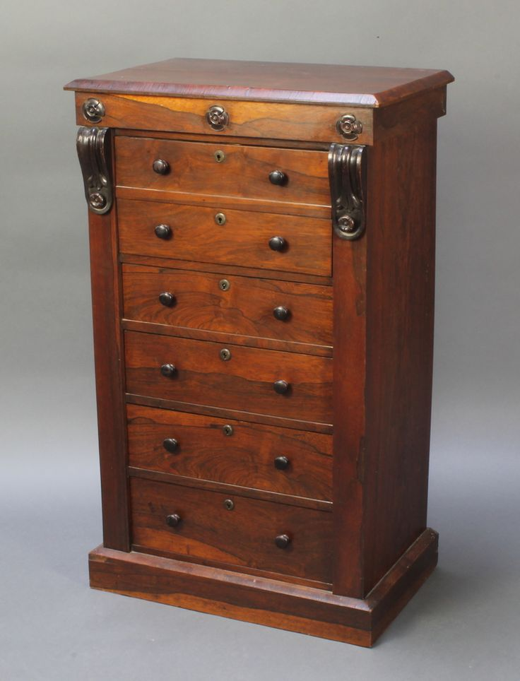 "Lot 851, A Victorian rosewood secretaire Wellington chest with vitruvian scrolls, the secretaire above 4 long drawers and plinth base 40""h x 24""w x 15""d est £260-360"