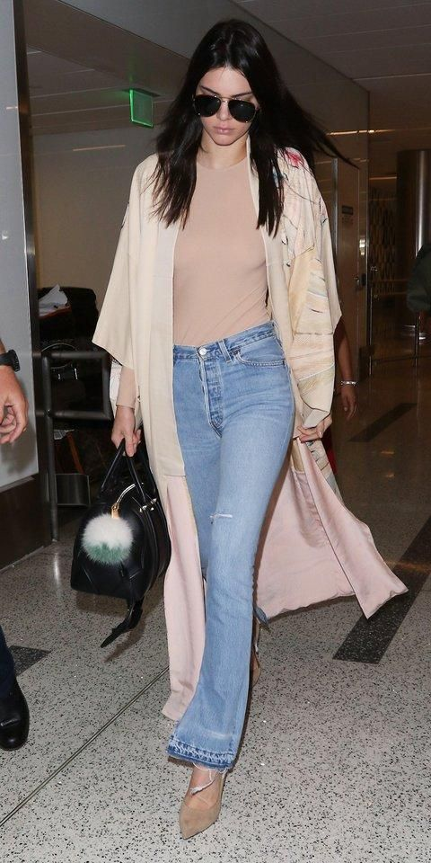Kendall Jenner in tie-dye hem, breezy duster, a nude top, and suede pumps.