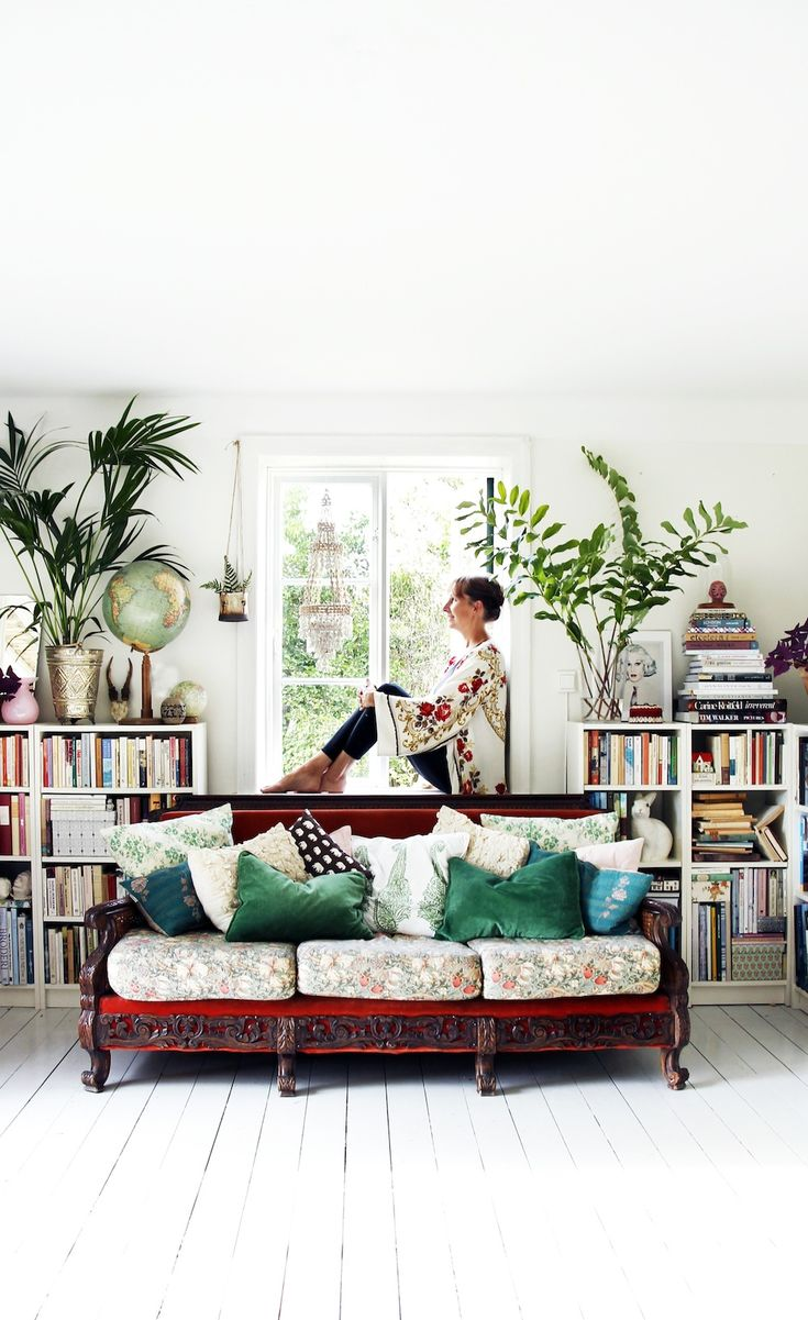Floral couch with green pillows