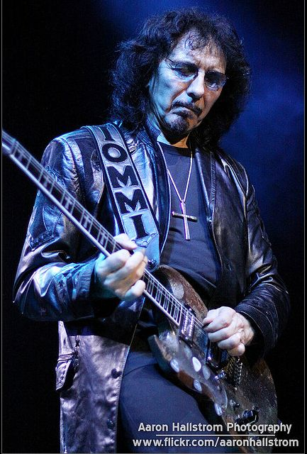 Tony Iommi, Single handedly invented heavy metal guitar riffs, with a disability which should have stopped him becoming a musician. HERO.