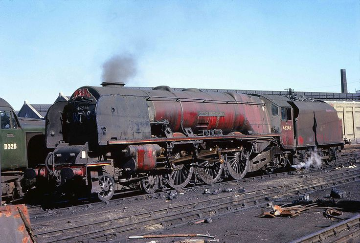 "46246 'City of Manchester'. Coronation Class 4-6-2. LMS Stanier Pacific 46246 ""City of Manchester"" will not be riding along in the breeze for much longer after this September 1962 shot was taken at Camden MPD.Photo by Captain Tower."