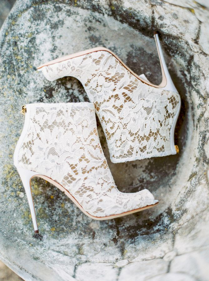 We're swooning over these chic lace booties: Photography: Yaroslav & Jenny