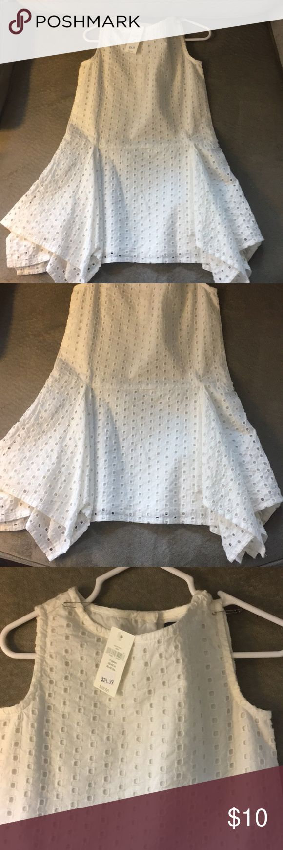 Baby Gap Dress—Brand New! Baby Gap dress brand new! Handkerchief style on the sides. Eyelet type fabric (see close-up). Smoke and pet free home. Baby Gap Dresses Casual