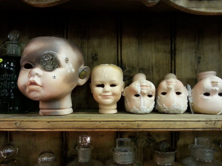 creepy dolls, bottles, curios, apothecary, assemblages