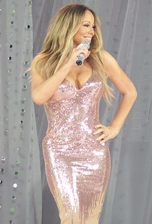 "MariahGMA. Referred to as the ""songbird supreme"" by the Guinness World Records, she is famed for her five-octave vocal range, power, melismatic style and signature use of the whistle register."