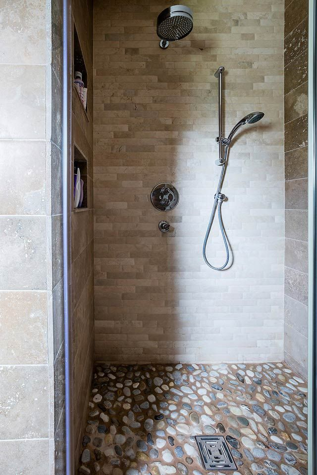 Natural Stone pebble mosaics on shower floor. These are a perfect alternative to a shower tray and add a sense of nature and  the outdoors inside!
