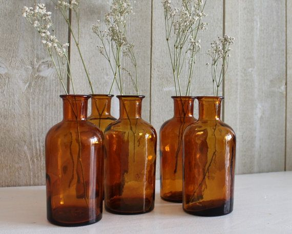 Bonjour,  This listing is for a collection of 5 old apothecary bottles made from deep amber glass, vintage french pharmacy bottles Beautiful rich