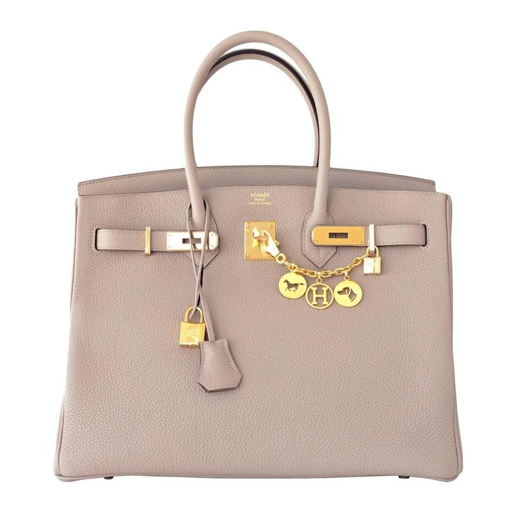 Hermes Gris Tourterelle 35cm Dove Grey Togo Birkin Gold GHW  - Hermes Gris Tourterelle 35cm Dove Grey Togo Birkin Gold GHW Tote Bag Chic  Brand New in Box. Store fresh. Pristine Condition. Perfect gift! Comes in full set with lock, keys, clochette, sleeper, raincoat, and signature orange Hermes box. Coveted Gris Tourterelle is a very sought-after Dove Grey. The most beloved neutral color from Hermes. Gris Tourterelle has been seen on so many celebs including Kim Kardashian, Heidi Mont...