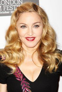 How do you put clips in adult hair like this without looking juvenile? Madonna's looks good.