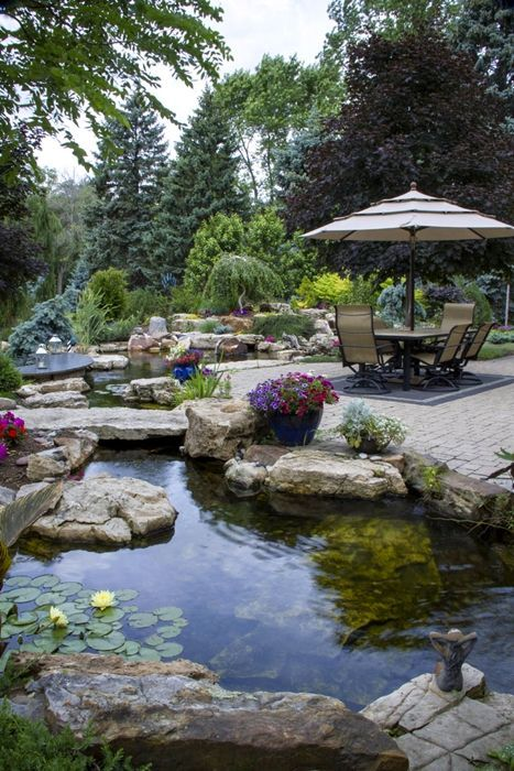 Large and beautiful pond in this outdoor living space.  #ponds. #waterfeature homechanneltv.com