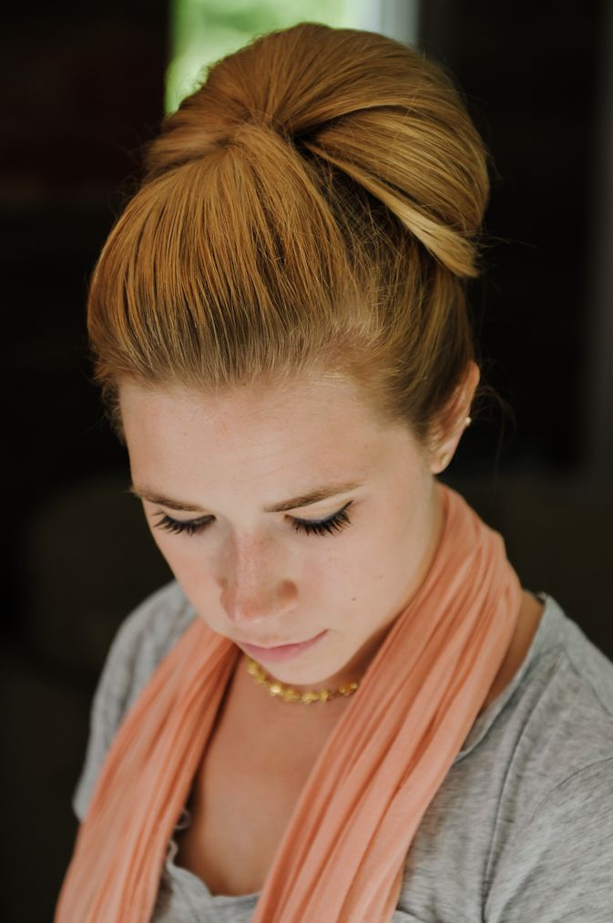 Twisted chignon w/ tutorial ... would need some tweaking to work with my hair, but is very pretty! (Sidewalk Ready)