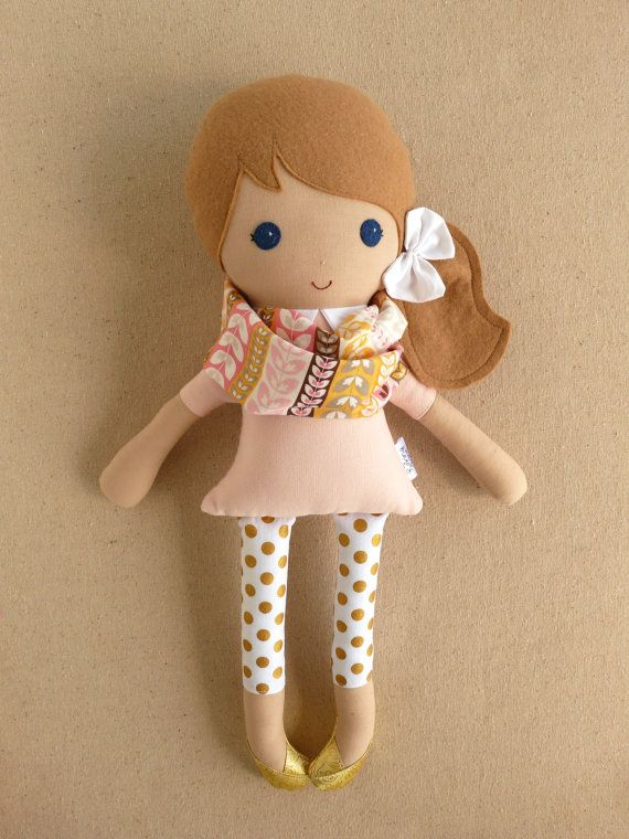 Reserved listing for Audra: This is a handmade cloth doll measuring 20 inches. She is wearing a sweet, pale pink dress with a matching removable
