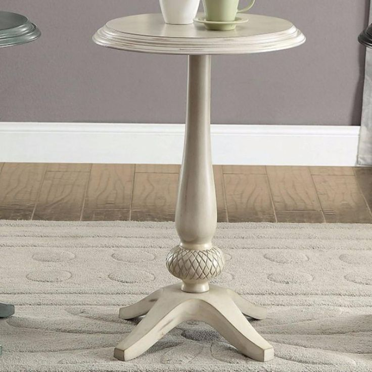 Round Accent Table, Antique White. Place this decorative Round Accent Table, Antique white, alongside your seat for a convenient place to set a drink or book on without sacrificing your home. Dimensions: 17x17x26 Material: Solid Wood & Others Finish:  Color: Antique White Lead Time: 3 to 10 business days UPC: 817231021168
