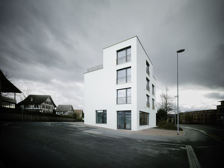 Completed in 2015 in Cham, Switzerland. Images by Valentin Jeck . The multi-family house in Schluechtstrasse is the opening of housing structure in Cham.  Through the language and position of the attic the building...