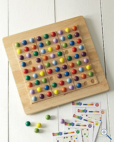 "Colorku: Color version of Sudoku complete with wooden board, 81 wooden marbles, puzzle cards, cardholder, solution sheet and plastic lid. 13 1/2 x 13 1/2"". $30"