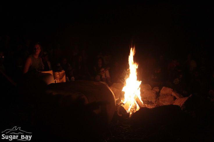 Bonding around a beach bonfire.