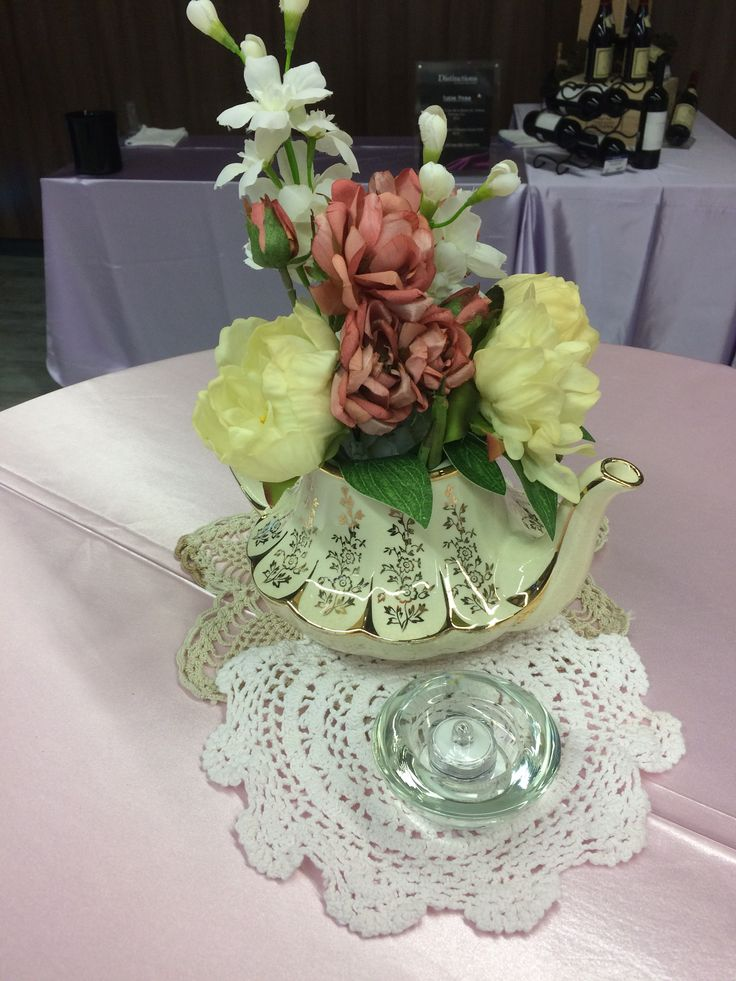 Spring Tea Event decor, Wonderland theme. Tea pots, flowers, doilies, candles
