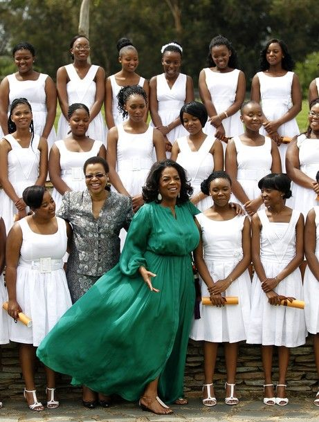 Oprah Winfrey posing in South Africa with her Leadership Academy for Girls graduates!  On January 14, 2012, these graduates became the first to graduate from Oprah's school based in Henley-on-Klip, outside Johannesburg.