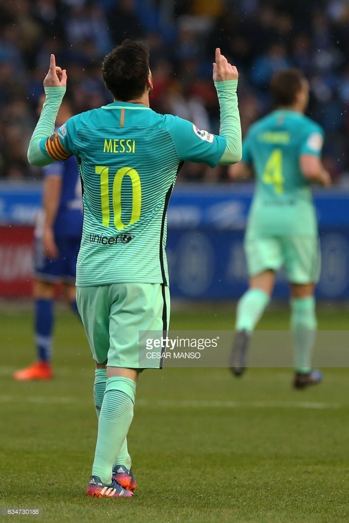 Barcelona's Argentinian forward Lionel Messi celebrates after scoring  during the Spanish league football match Deportivo Alaves