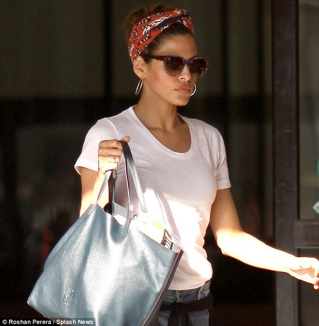 In the (land) army! Eva Mendes accessorised her casual outfit with a quirky headscarf as she stepped out in Los Angeles on Wednesday