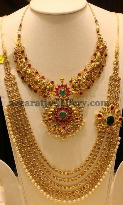 22kt jewelry with rubies, emeralds and pearls..