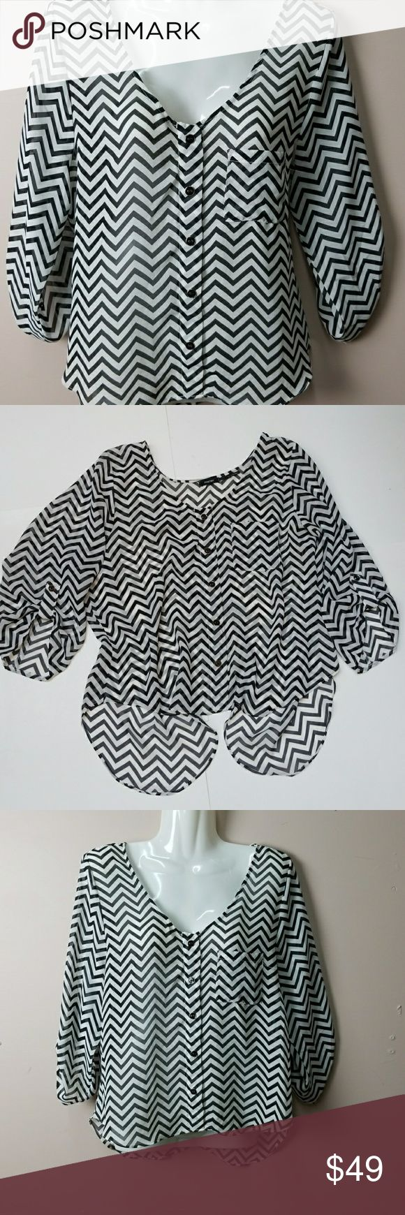 Poetry Blouse/Top Plus L Poetry Blouse/Top Plus Size L. Size L, Chevron Print, black and white, elastic sleeves, hi-lo, 3/4 length sleeves that button up, over laps in back, relaxed, loose fitting,  sheer fabric, decorative buttons down front and a pocket in front. Poetry Tops Blouses