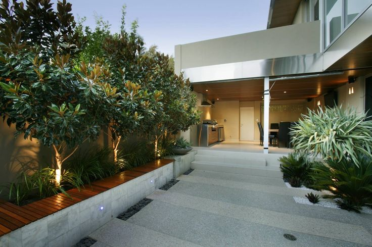 Excelsior | Tim Davies Landscaping. seating with trees lining the wall.