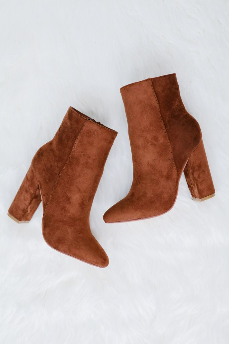 • Camel color ankle high heeled booties • Available in sizes 5.5 - 10 U.S. Standard • Clean with a damp cloth