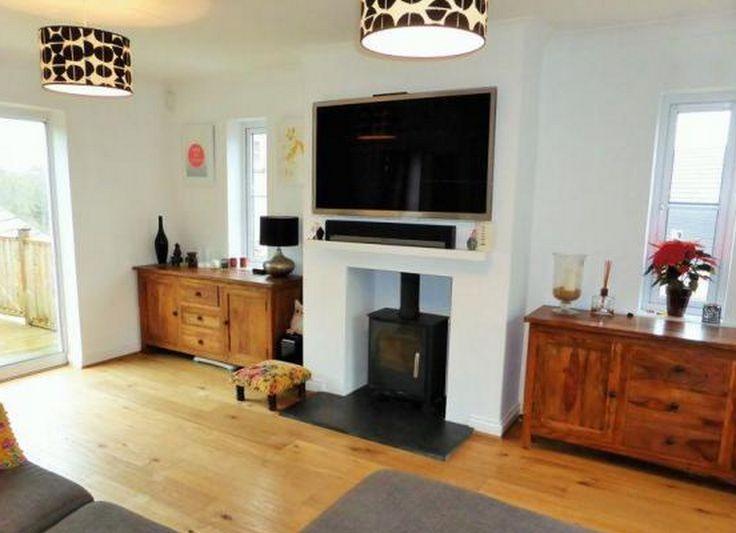 TV over log burner
