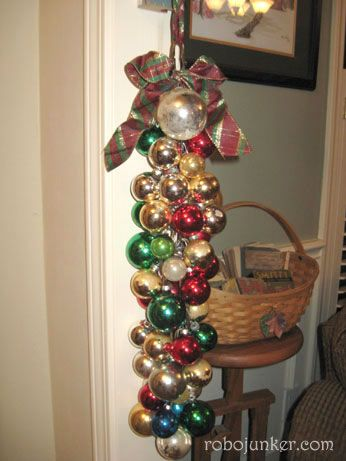 For this project, take a chain, and start hanging balls from it. Use 2 sizes of hooks, and load it up. Tie a ribbon at the top.