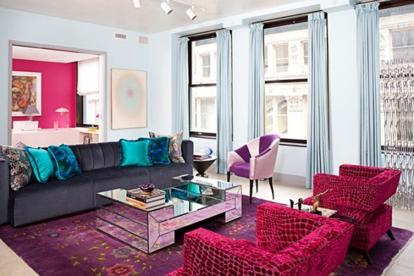 Sometimes your living room walls may not be the surfaces that need to stand out. Let walls of an adjacent room make a big statement, as shown below in a space designed by Rafael de Cardenas. Who needs jewel-toned living room paint when a hot pink wall in the next room can inspire an entire space full of rich decor? [from Architecture at Large]